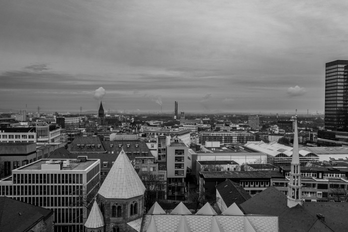 The north of Essen from above. Lots of rooftops and a thick cover of clouds in the sky.