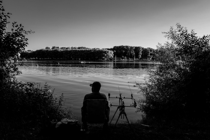 A fisher, sitting and waiting