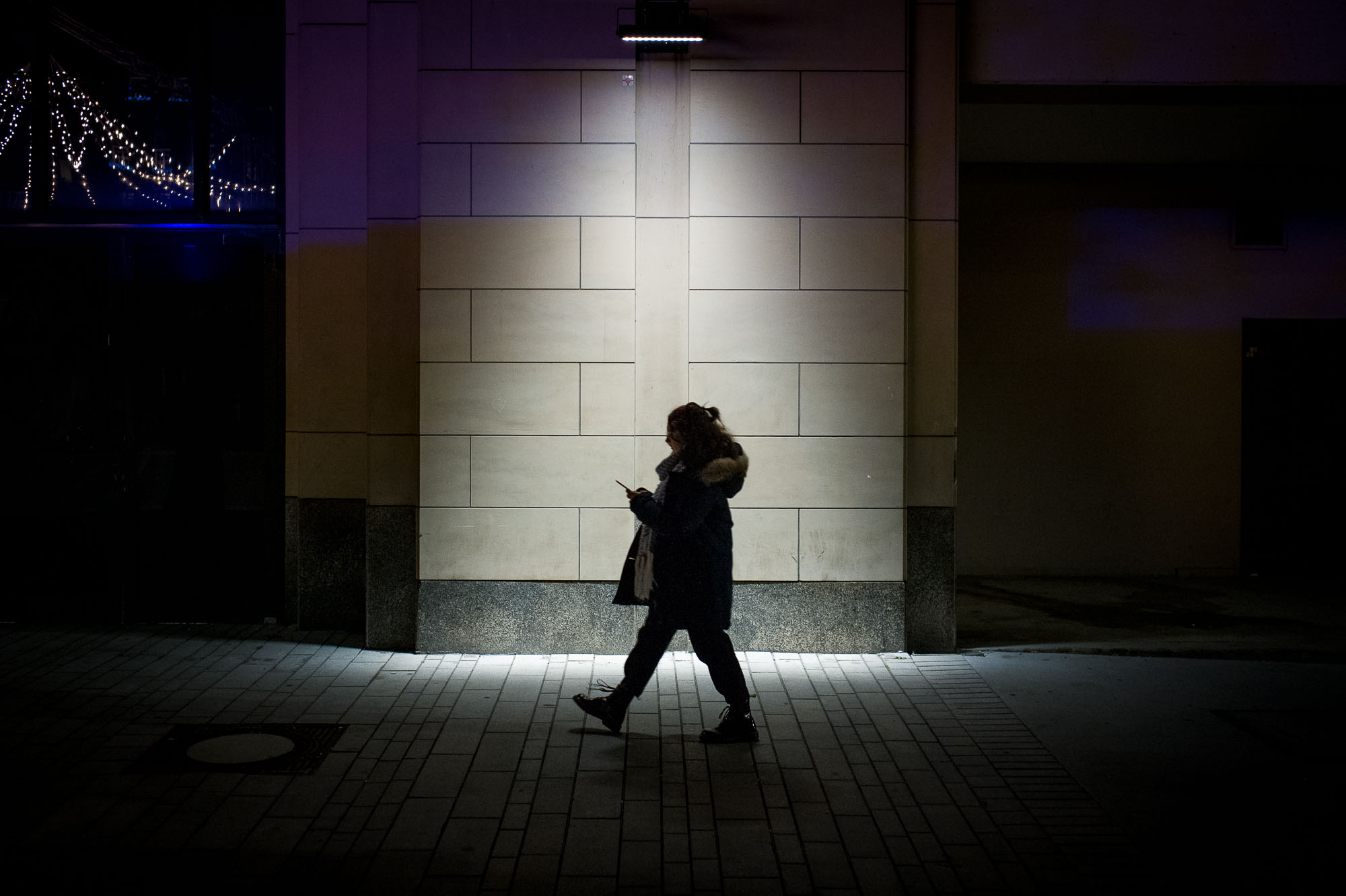 Woman walking through a cone of light