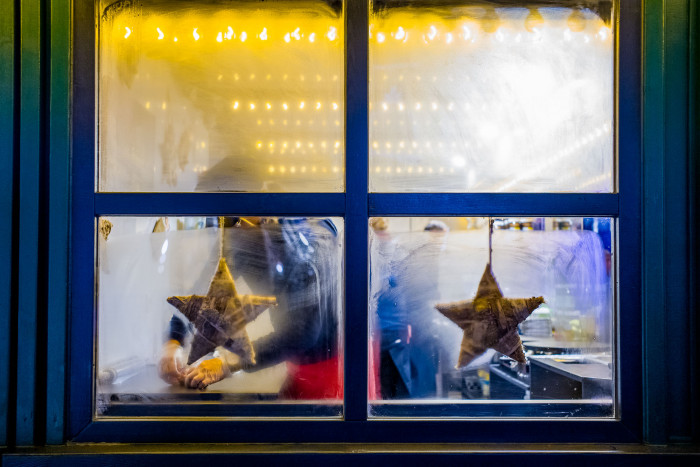 Fogged up window with two stars