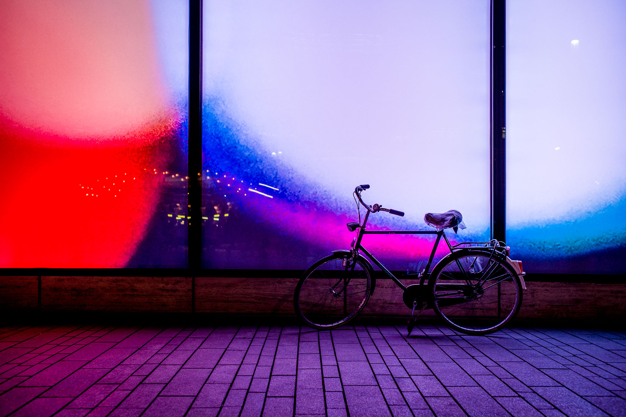 Bike in front of a colorful background