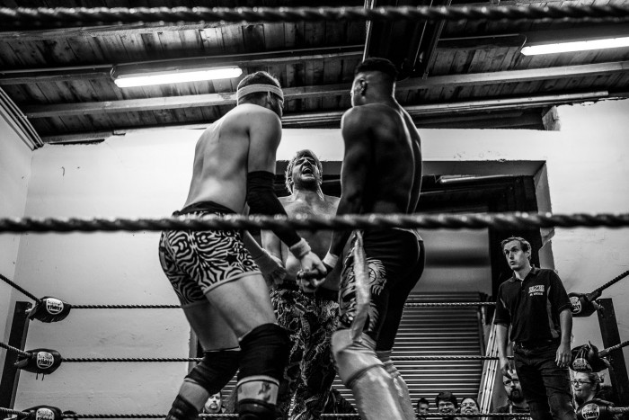Three wrestlers lock up