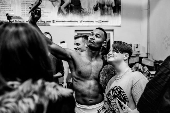 Wrestler Francis Kaspin takes a selfie with a fan