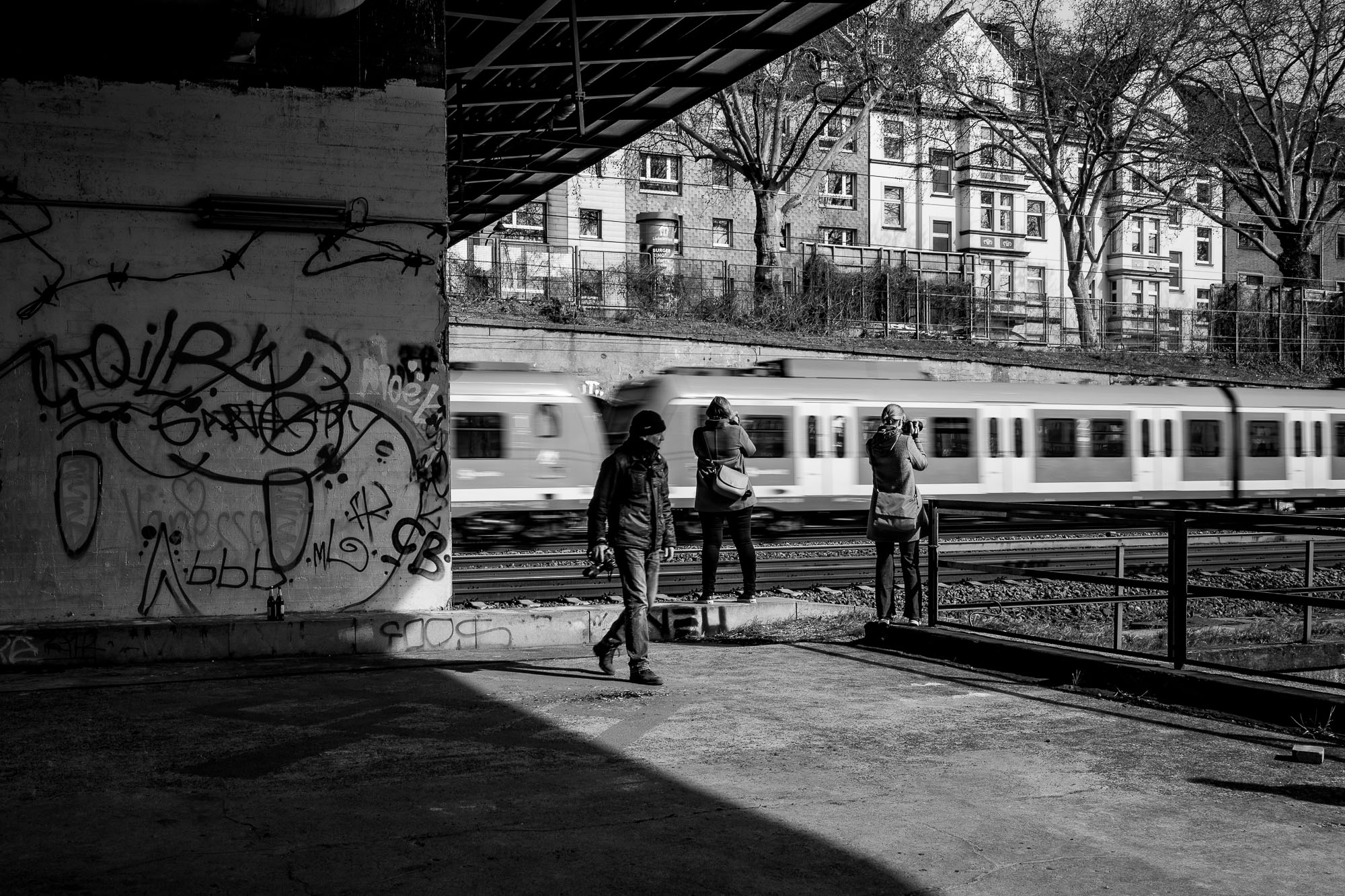 Photographers taking photos of a train passing by