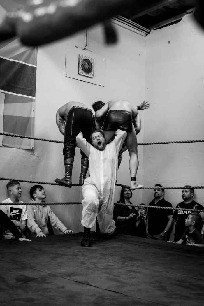 Sequence 1 of 5: Wrestler Matthias Bernstein is about to powerbomb his opponents Maggot and Prince Ahura