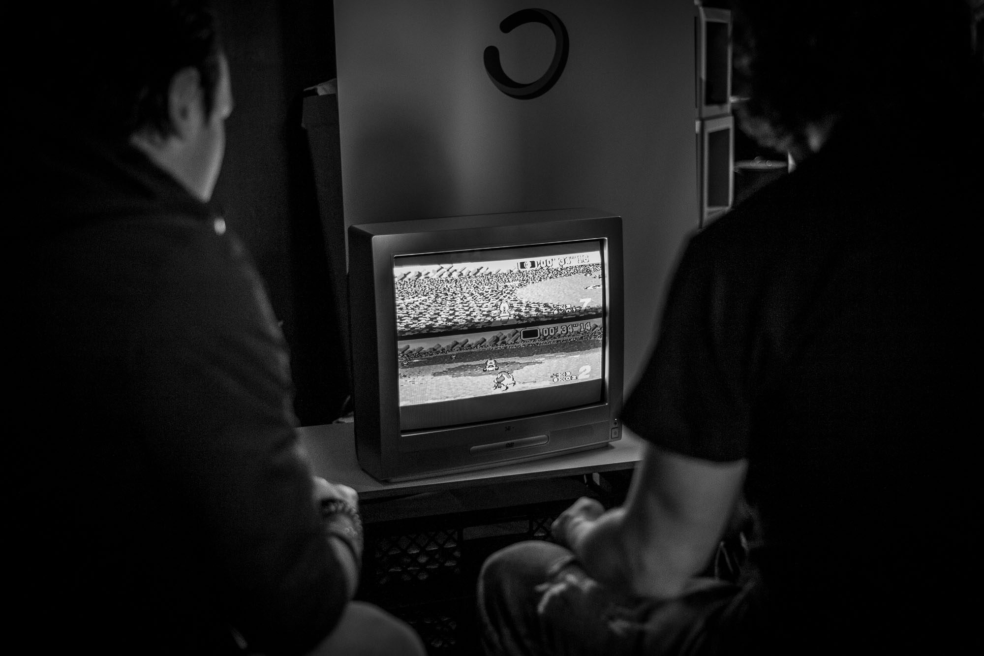 Two attendees playing Mario Cart