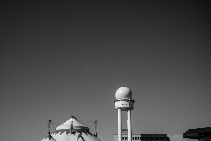 Old water tower next to a circus tent