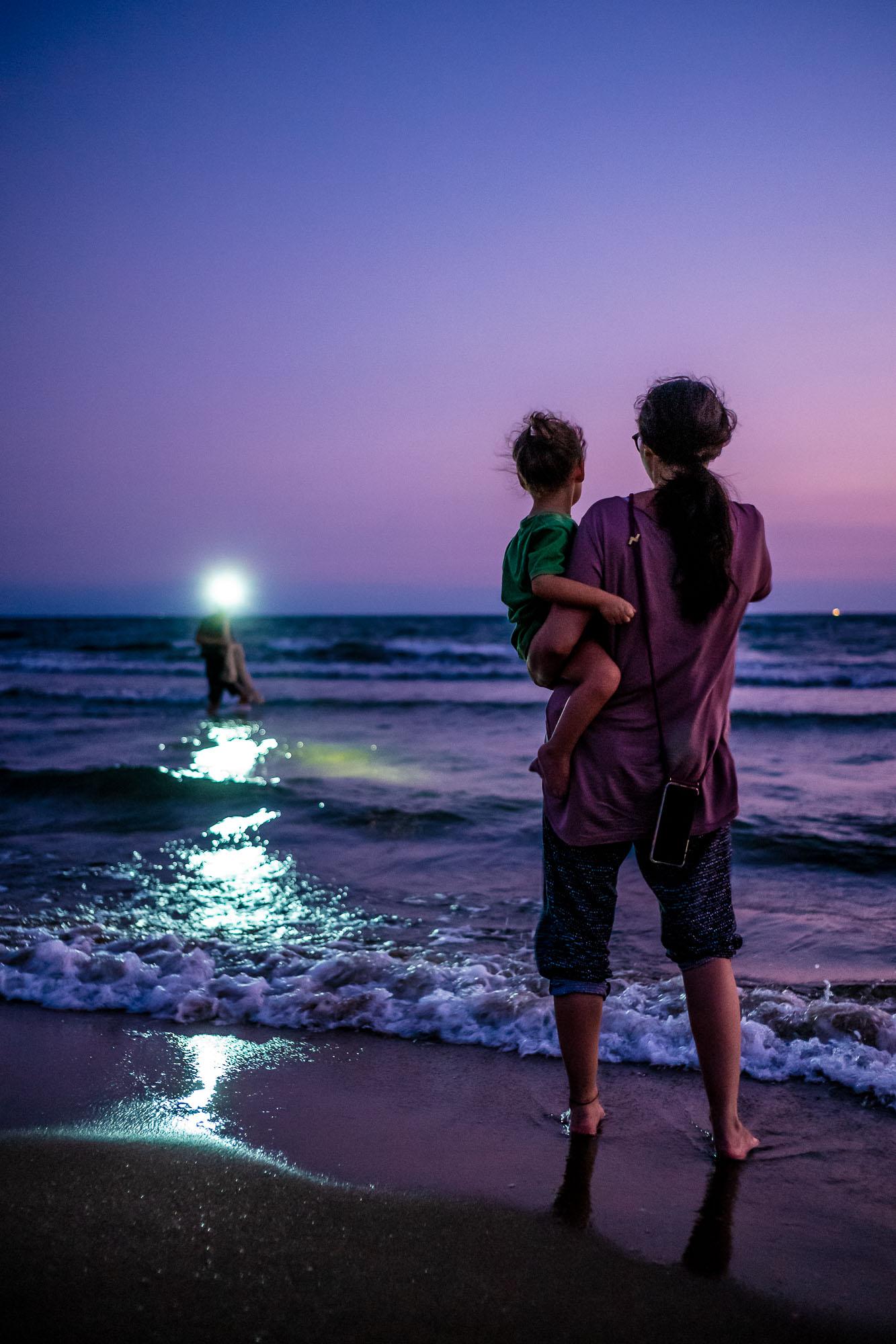 Lumi & Ulya watching a fisherman during sunset at Burnaz beach