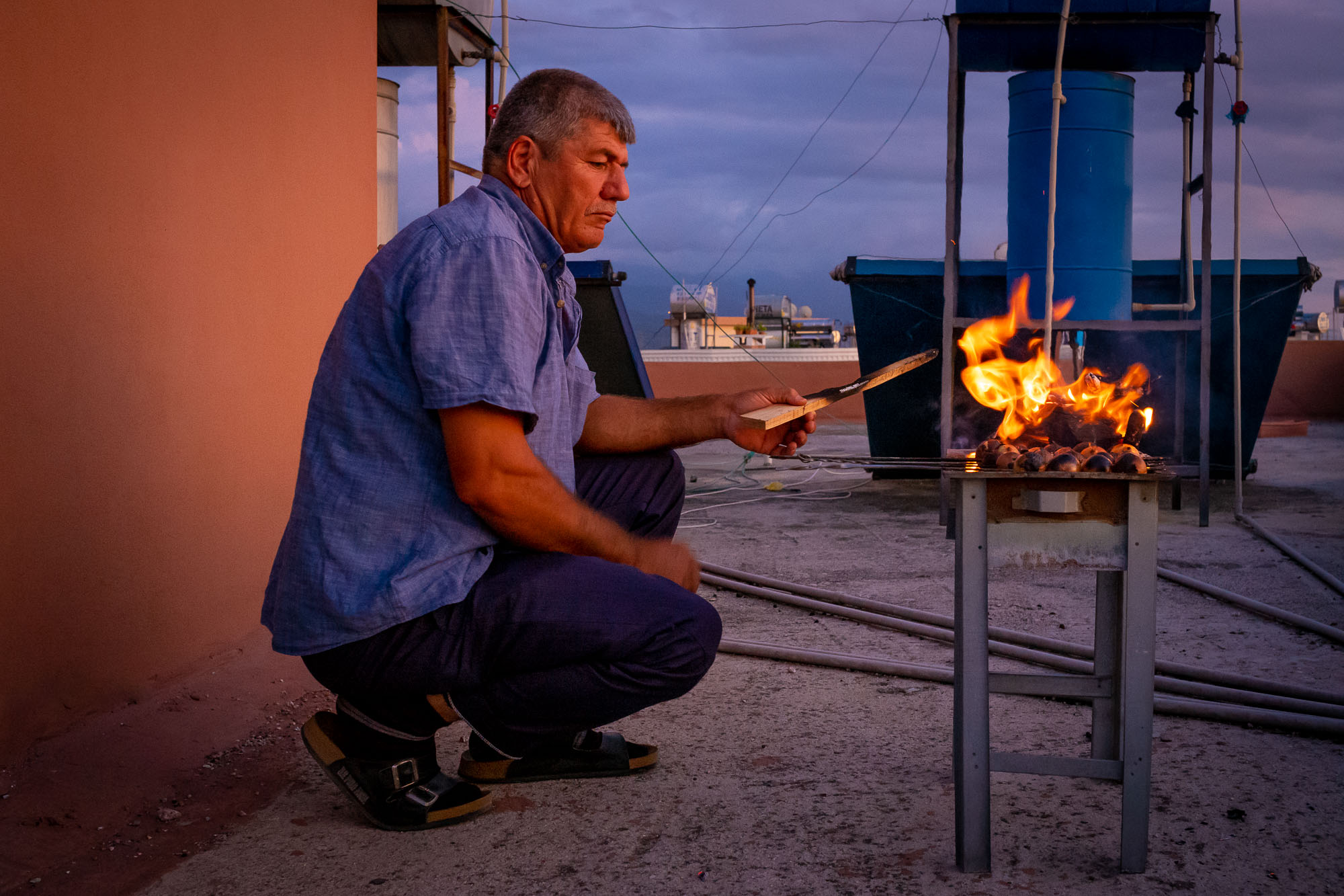 Preparing the grill for cooking on a rooftop