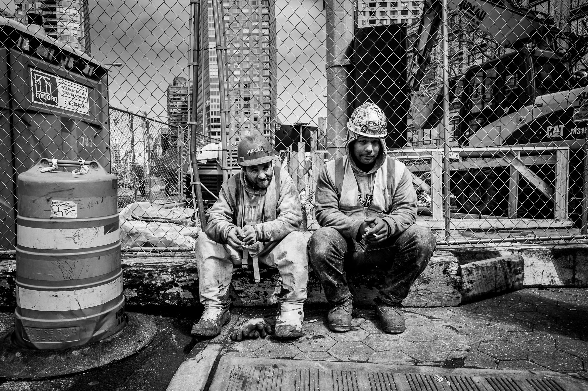 Two construction workers taking a break