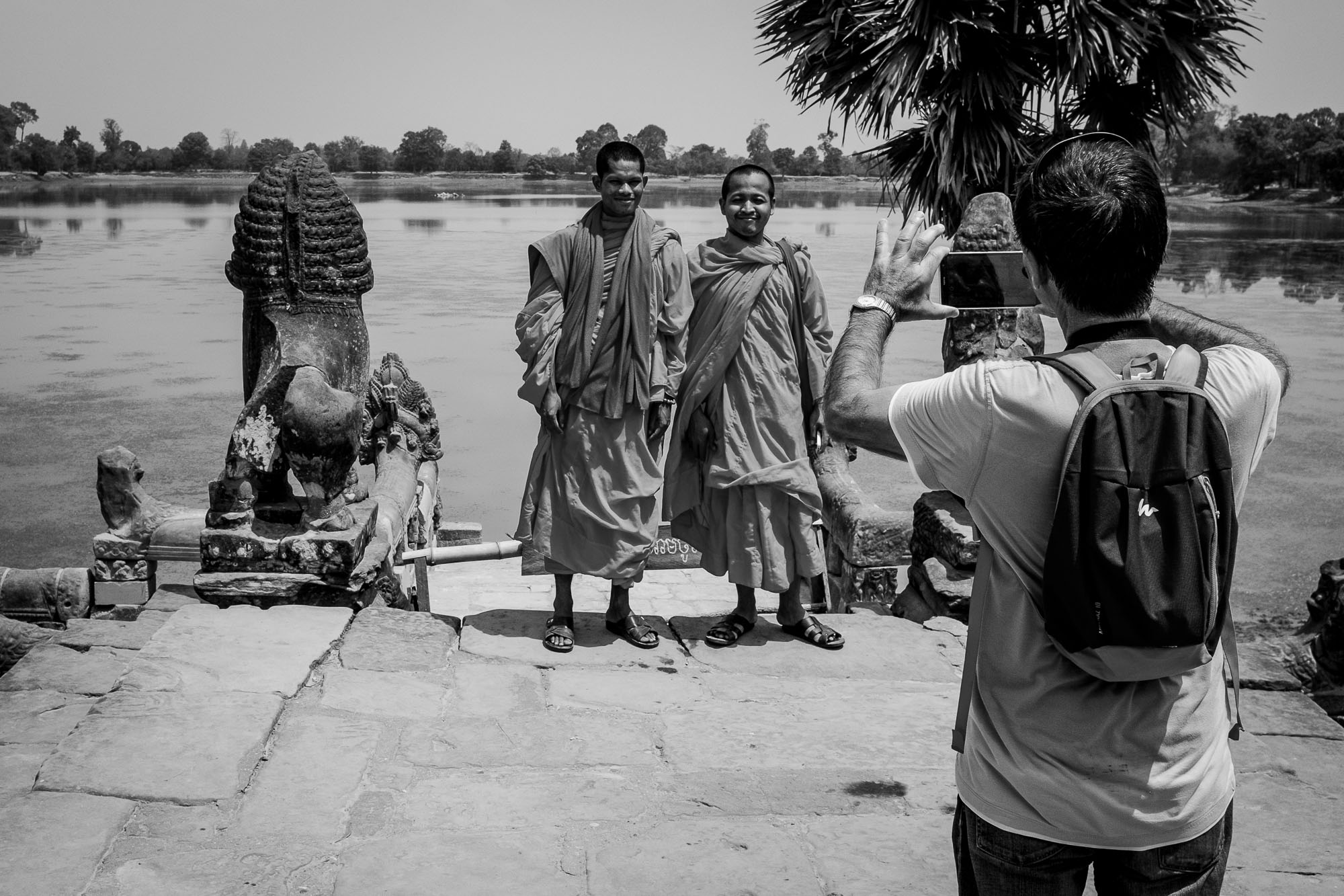 Two monks getting their picture taken at a temple in Angkor Wat