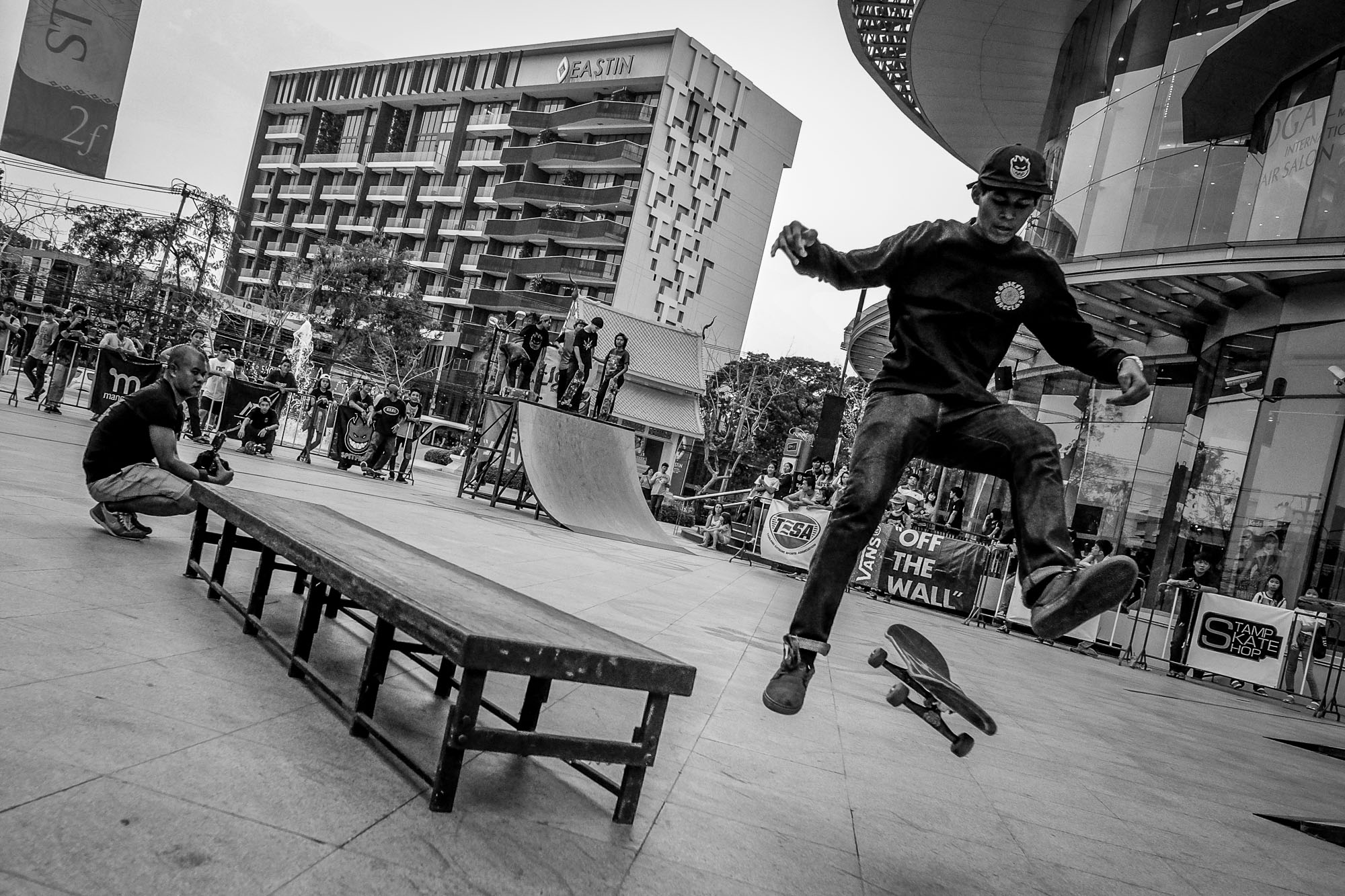 Dude doing a kickflip from a rail