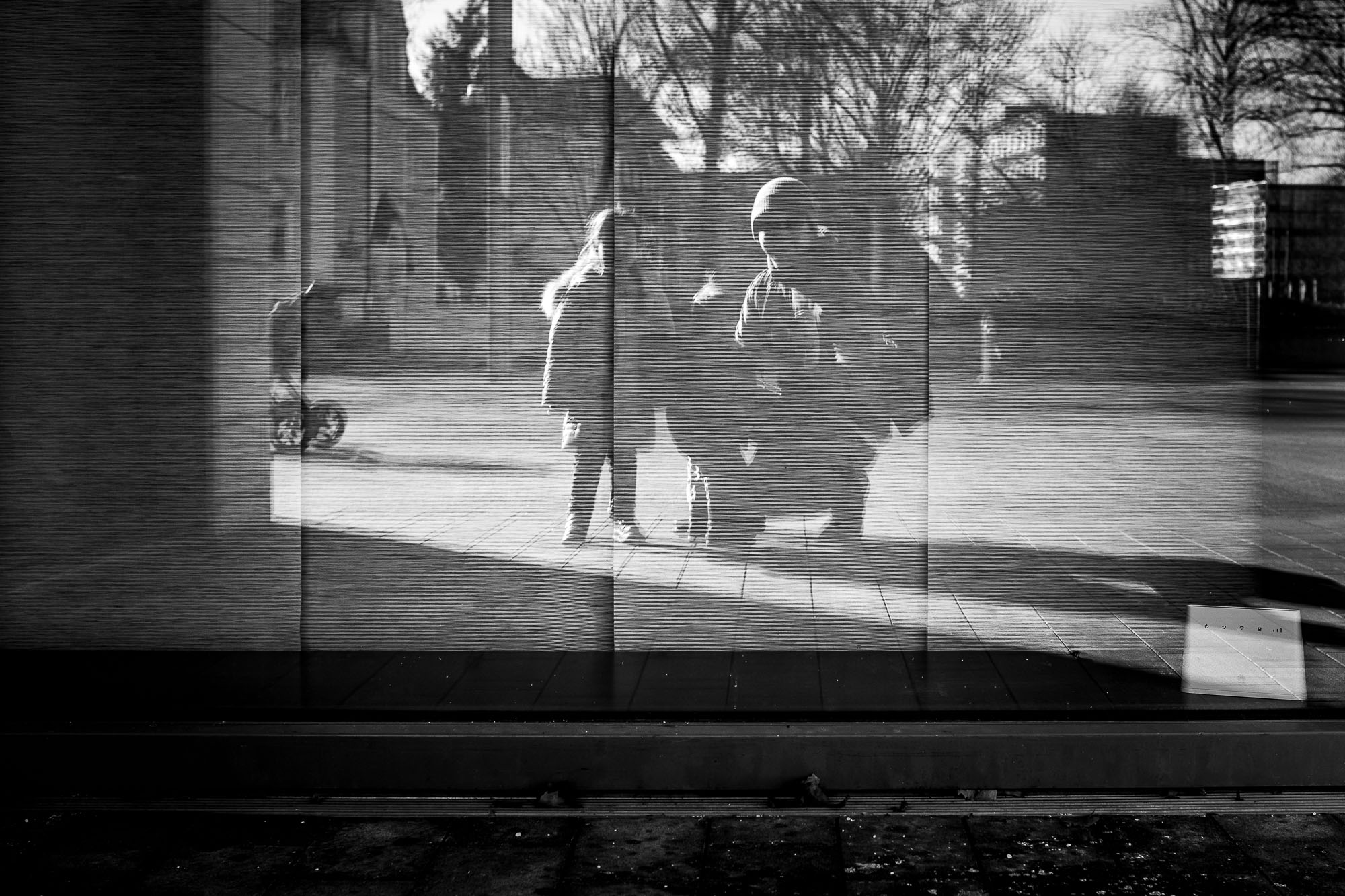 Reflection of my two girls and me in a window