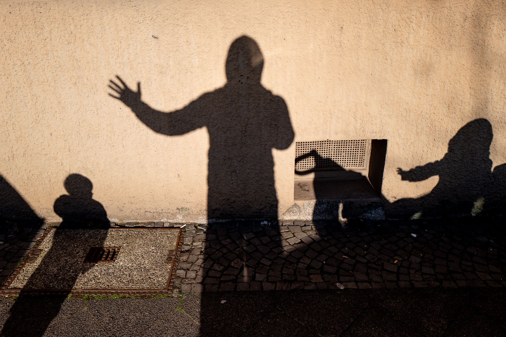 My children and I as shadows on a wall