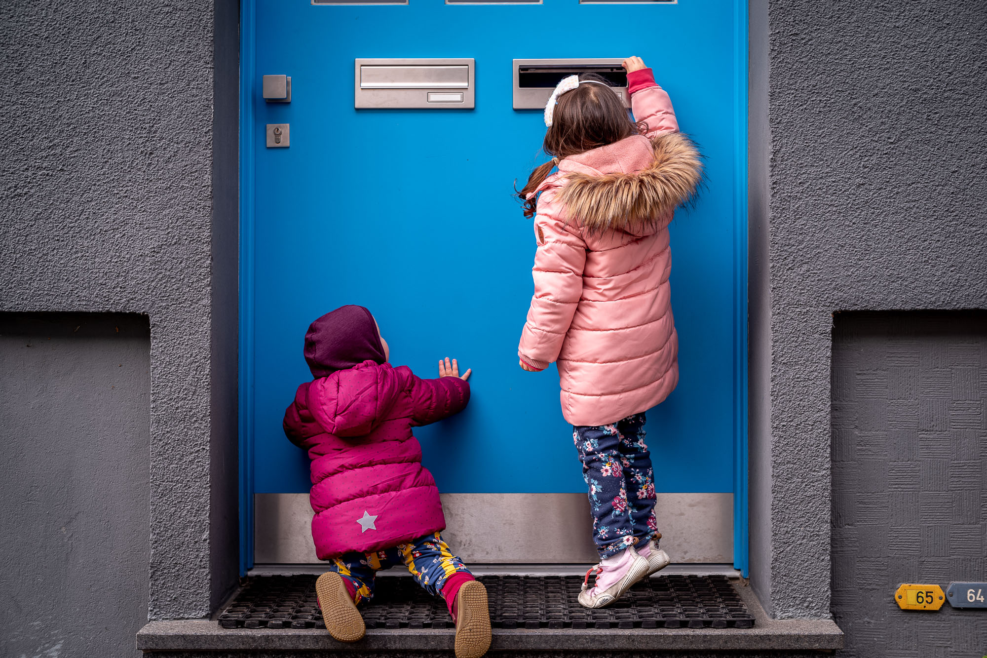 My two daugthers exploring a blue door