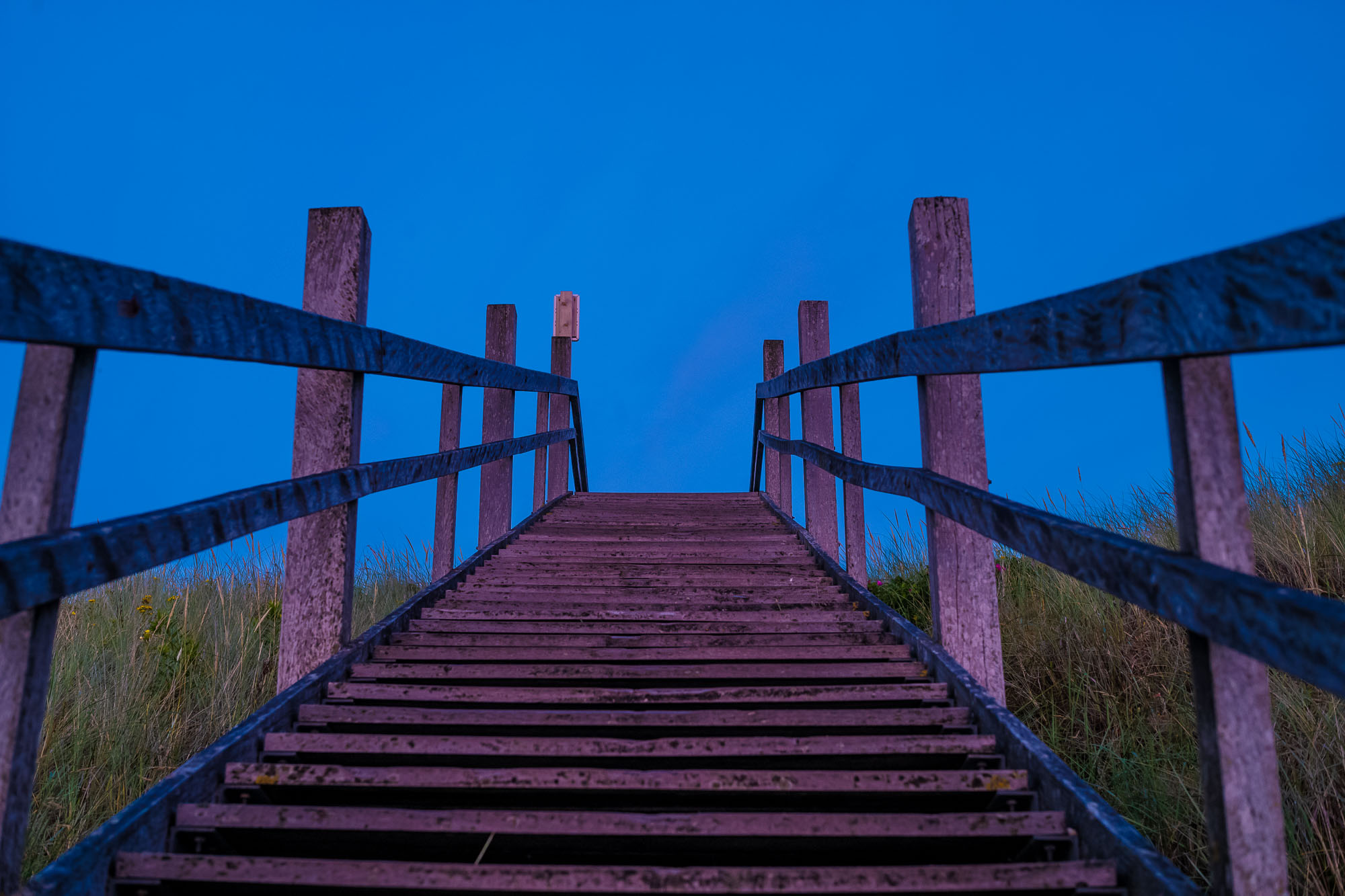 Staircase at Domburg beach, bathed in pinkish sunset light