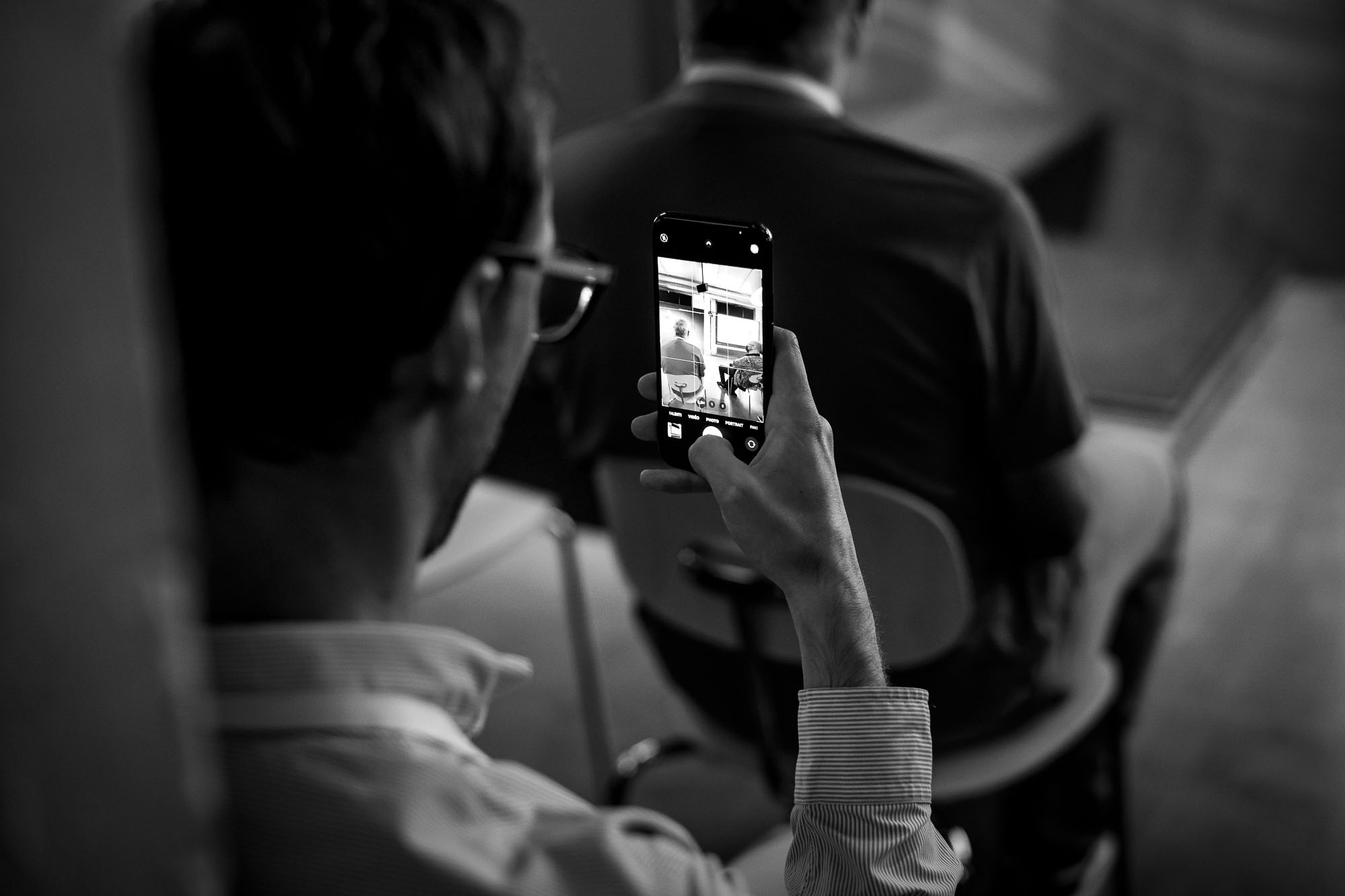 An attendee taking a photo with his smartphone